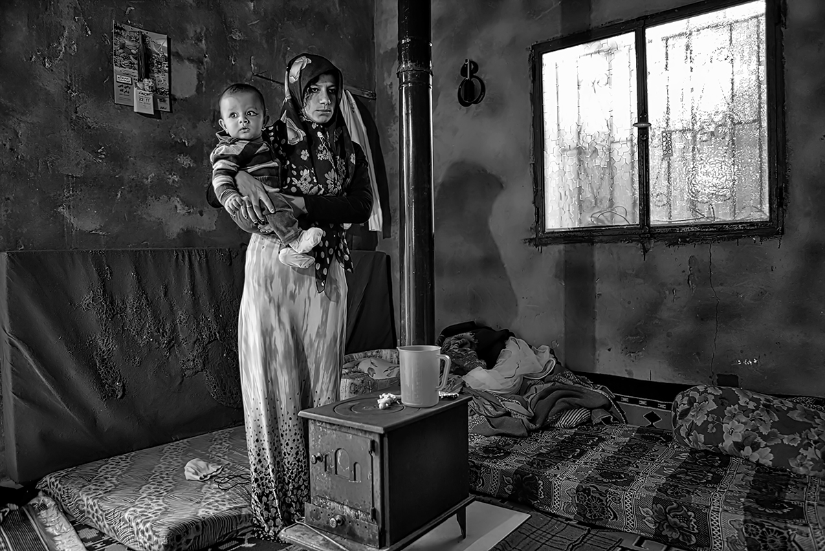 """a mother with her baby inside the """"one room house"""" (Kfemabrak Chouf, one hour and half by car from Beirut, at 1200 m on sea level)."""
