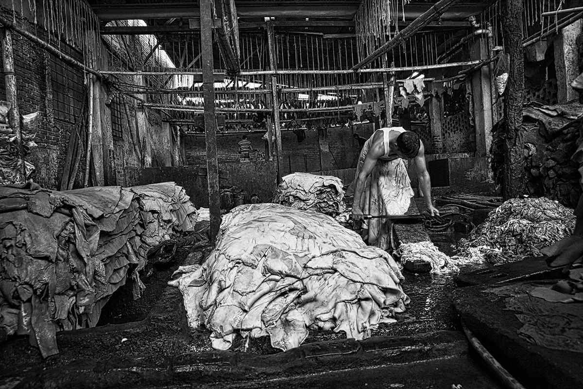 Man at work inside a leather's factory in Dacca.