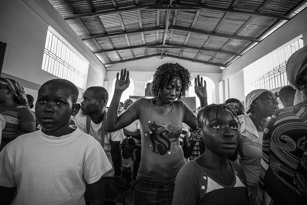 'REMEMBERING THE DEAD' - PORT-AU-PRINCE, HAITI. JANUARY 12, 2015. At a memorial service inside the Grand Cemetery Church on the occasion of the fifth anniversary of the 2010 earthquake.