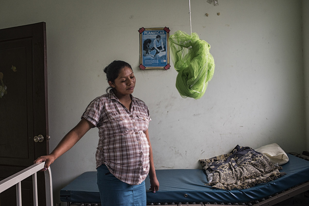 Sonsonate, El Salvador-May 2016: Flor Marlene Morales in labor at the maternal waiting house in Sonsonate. who is 15 and from the Juayua municipality arrived at the clinic 40 weeks pregnant, by herself. Her father was assasinated by gangs and she lives with an aunt and her grandmother. The maternal waiting houses especially help women who come from areas without access to a nearby hospital wait out the end of the pregnancies in order to be close to a hospital and avoid complications. Pregnant women in today's El Salvador face a whole host of challenges from the threat of the mosquito born illness, Zika which has been linked to the grave condition of microcephaly in newborns, to the constant threat of gang violence with one of the highest murder rates in the world, to an increasing rape epidemic. However the most important threat to women's reproductive rights is by far the State's criminal ban on abortion. Doctors and nurses are trained to spy on women's uteruses in public hospitals, reporting any suspicious alteration to the authorities and provoking criminal charges which can lead to between 6 months to 7 years in prison. It is the poorer class of women who suffer the most as doctors in private hospitals are not required to report. Roughly 25 women are serving 30 to 40 year sentences on homicide charges for allegedly killing their newborn children. Although the women's stories, most of which resemble premature births or late term miscarigaes are often dismissed in trials, laced with moral accusations, based little on the consitution and scientific facts. ©Nadia Shira Cohen