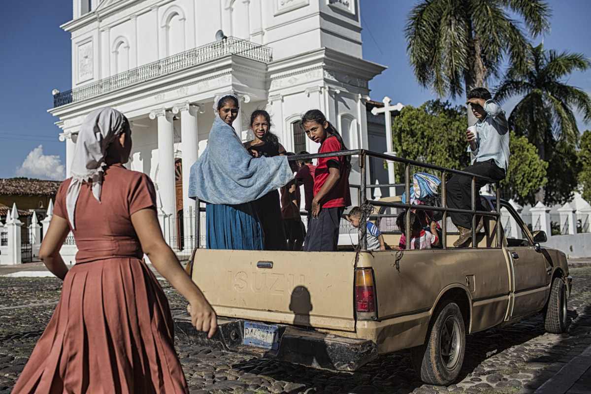 August 2016-Suchitoto, El Salvador: Pentacostals in a pick up truck outside of The Santa Lucia Cathedral in Suchitoto. ©Nadia Shira Cohen