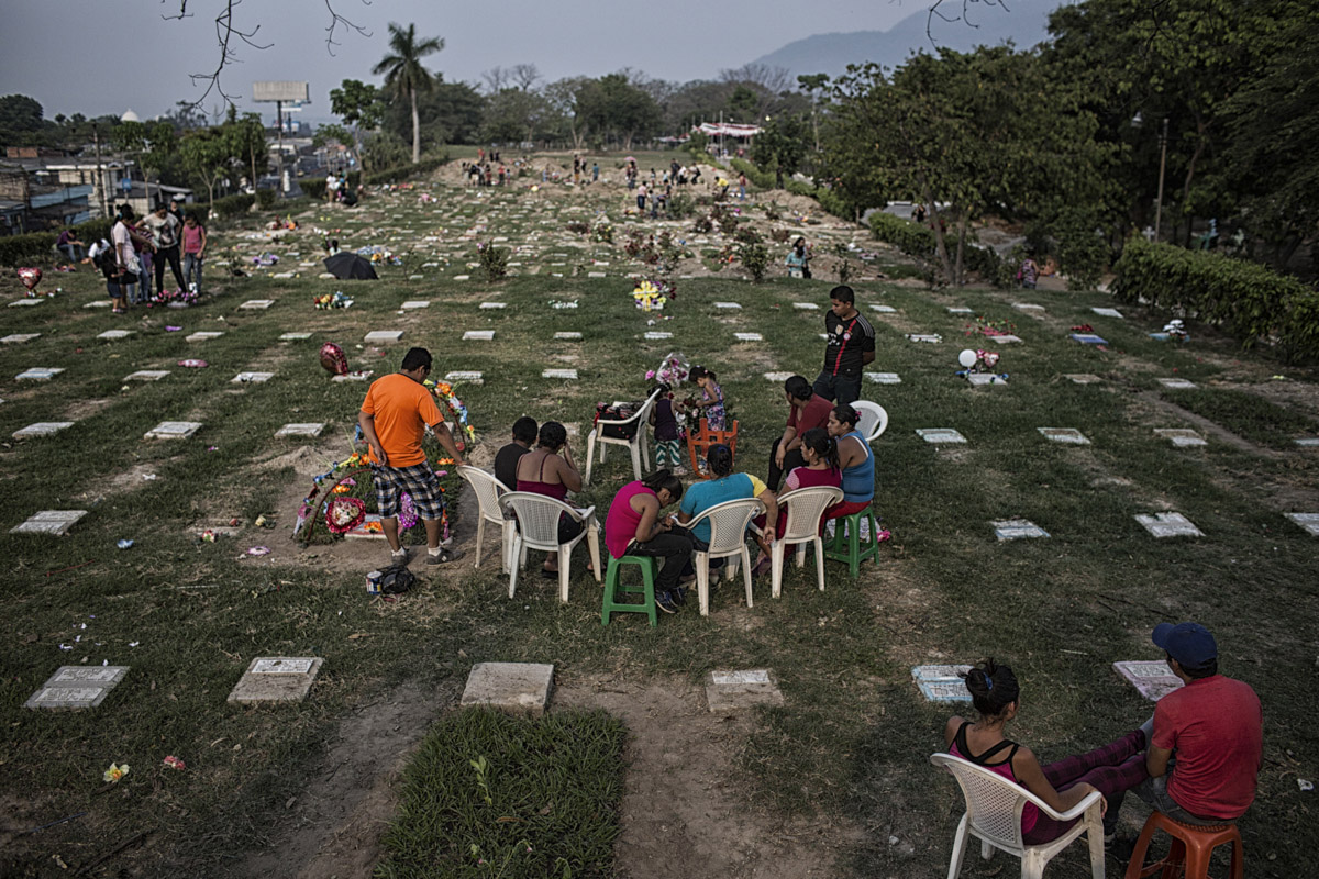 San Salvador, El Salvador-May 2016: Families gather at the general cemetary to pay tribute to their mothers on Mother's Day. Pregnant women in today's El Salvador face a whole host of challenges from the threat of the mosquito born illness, Zika which has been linked to the grave condition of microcephaly in newborns, to the constant threat of gang violence with one of the highest murder rates in the world, to an increasing rape epidemic. However the most important threat to women's reproductive rights is by far the State's criminal ban on abortion. Doctors and nurses are trained to spy on women's uteruses in public hospitals, reporting any suspicious alteration to the authorities and provoking criminal charges which can lead to between 6 months to 7 years in prison. It is the poorer class of women who suffer the most as doctors in private hospitals are not required to report. Roughly 25 women are serving 30 to 40 year sentences on homicide charges for allegedly killing their newborn children. Although the women's stories, most of which resemble premature births or late term miscarigaes are often dismissed in trials, laced with moral accusations, based little on the consitution and scientific facts. ©Nadia Shira Cohen