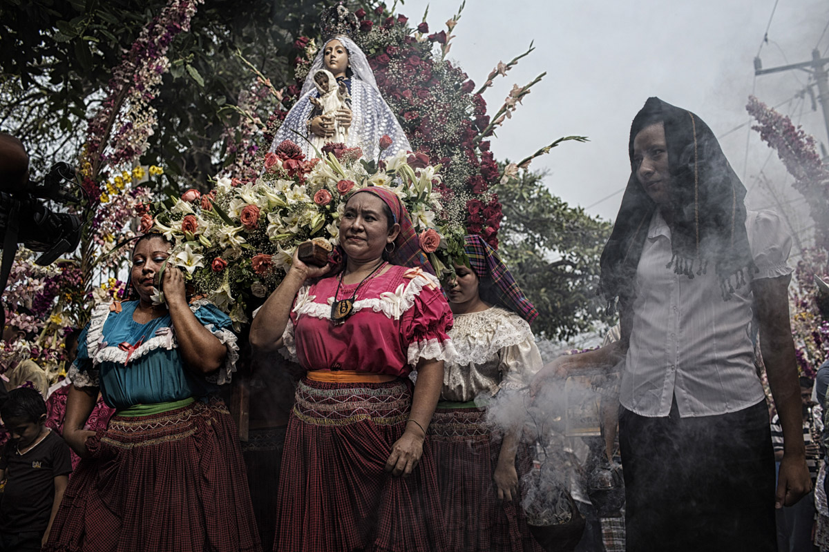 Panchmalco, El Salvador-May 2016: Women of the community carry the Virgin Mary on their backs on a procession through the town of Panchimalco. The annual Palms Festival features a procession of the Virgin Mary through the town's narrow streets and attracts people from all over the country as well as internationally who come to idolize her. Pregnant women in today's El Salvador face a whole host of challenges from the threat of the mosquito born illness, Zika which has been linked to the grave condition of microcephaly in newborns, to the constant threat of gang violence with one of the highest murder rates in the world, to an increasing rape epidemic. However the most important threat to women's reproductive rights is by far the State's criminal ban on abortion. Doctors and nurses are trained to spy on women's uteruses in public hospitals, reporting any suspicious alteration to the authorities and provoking criminal charges which can lead to between 6 months to 7 years in prison. It is the poorer class of women who suffer the most as doctors in private hospitals are not required to report. Roughly 25 women are serving 30 to 40 year sentences on homicide charges for allegedly killing their newborn children. Although the women's stories, most of which resemble premature births or late term miscarigaes are often dismissed in trials, laced with moral accusations, based little on the consitution and scientific facts. ©Nadia Shira Cohen