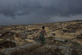 A refugee boy trying to protect his makeshift home from the rain in Kutupalong newly expanded camp on March 6, 2017 in Cox's Bazar, Bangladesh. About 70,000 Rohingya Muslims have fled to Bangladesh from Myanmar since October 9, 2016 after the Burmese military launched clearance operations in response to an attack on border police. The U.N. human rights office said in a report that Myanmar's security forces had committed mass killings, torture and gang rapes of Rohingya Muslims and burned their villages.Since 1992, about 32,000 registered Rohingya have been living in two United Nations camps near Cox's Bazar, but estimates of unregistered refugees range from 200,000 to 500,000. Many of them live in two sprawling makeshift shelters close to the official camps, while others are scattered across southeast Bangladesh. As a result, most of these unregistered refugees are suffering. Basic food, medical care and safety are not available in these camps, thus creating an insecure and vulnerable life.