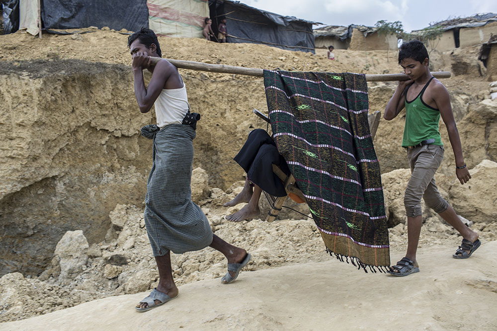 Fatema Khatun(50) is a Rohingya refugee, who fled from violence against Muslim in Myanmar, is being carried on bamboo to the hospital due to lack of transportation in Kutupalong refugee camp on March 6, 2017 , Cox's Bazar, Bangladesh.