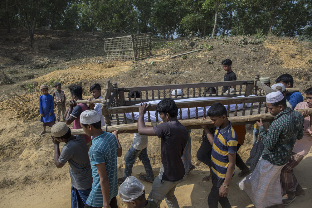 Rohingya refugees attend the funeral of Khalek, 16, who died from Diarrhea in Kutuplanong refugee camp on March 05, 2017, Cox's Bazar, Bangladesh.
