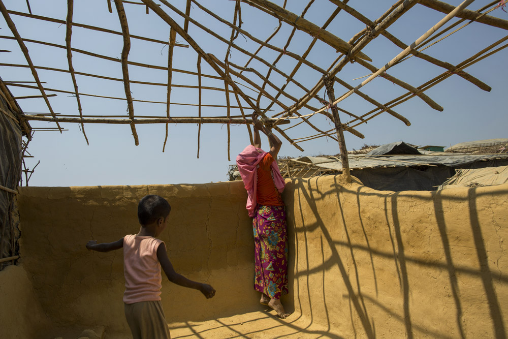 A Rohingya refugee woman makes new shelter in Kutupalong refugee camp.