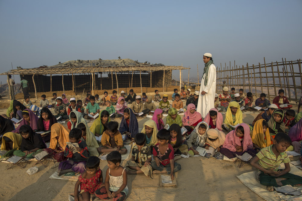 Rohingya refugee children attend an open air Arabic school in Kutupalang newly expanded Refugee Camp, where they learn to read the Quran.