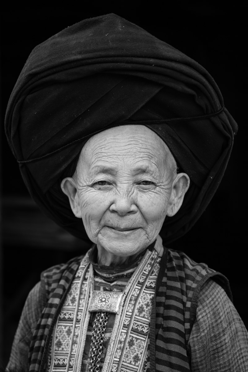 Portrait of a woman in her traditional clothes, worn by Dao people.