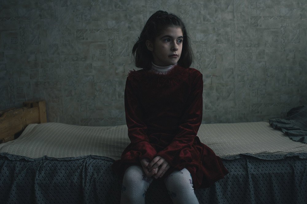 Lilia Kovaleva is hospitalized in a Belarusian orphanage for children with mental problems. The radioactive consequences are many and diverse.